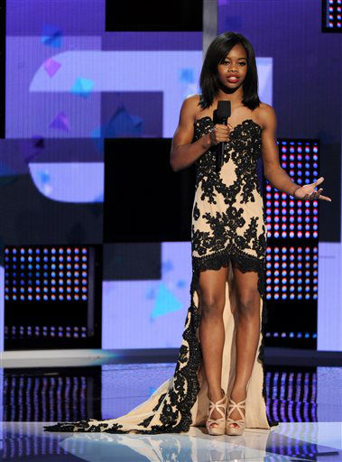 "<div class=""meta ""><span class=""caption-text "">Gabby Douglas speaks onstage at the BET Awards at the Nokia Theatre on Sunday, June 30, 2013, in Los Angeles. (Photo by Frank Micelotta/Invision/AP) (AP Photo/ Frank Micelotta)</span></div>"