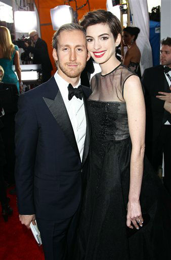 Adam Shulman, left, and actress Anne Hathaway arrive  at the 19th Annual Screen Actors Guild Awards at the Shrine Auditorium in Los Angeles on Sunday Jan. 27, 2013. &#40;Photo by Matt Sayles&#47;Invision&#47;AP&#41; <span class=meta>(Photo&#47;Matt Sayles)</span>