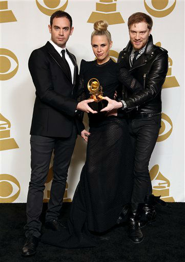 From left, Joseph Ray, Alana Watson and Daniel Stephans pose backstage with the award for best remixed recording non-classical for &#34;Promises&#34; at the 55th annual Grammy Awards on Sunday, Feb. 10, 2013, in Los Angeles.  <span class=meta>(AP photo)</span>