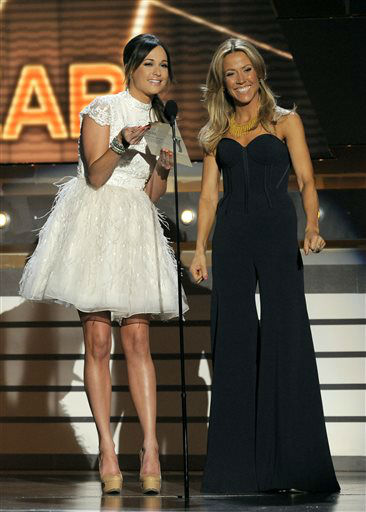Singers Kacey Musgraves, left, and Sheryl Crow speak on stage at the 48th Annual Academy of Country Music Awards at the MGM Grand Garden Arena in Las Vegas on Sunday, April 7, 2013.  <span class=meta>(AP photo)</span>