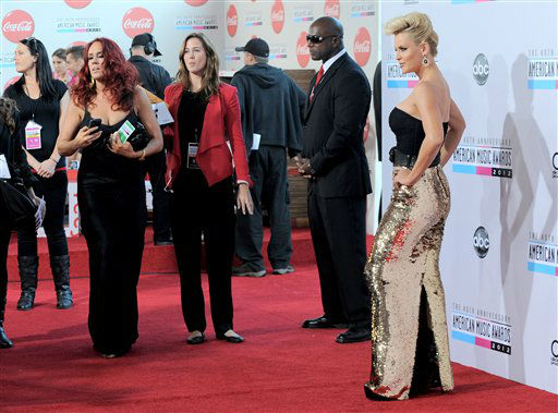 "<div class=""meta image-caption""><div class=""origin-logo origin-image ""><span></span></div><span class=""caption-text"">Jenny McCarthy arrives at the 40th Anniversary American Music Awards on Sunday, Nov. 18, 2012, in Los Angeles. (Photo by Jordan Strauss/Invision/AP)</span></div>"