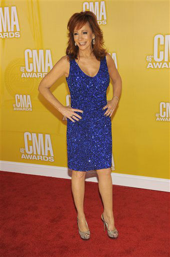 "<div class=""meta ""><span class=""caption-text "">Reba McEntire arrives at the 46th Annual Country Music Awards at the Bridgestone Arena on Thursday, Nov. 1, 2012, in Nashville, Tenn.   (Photo/Chris Pizzello)</span></div>"