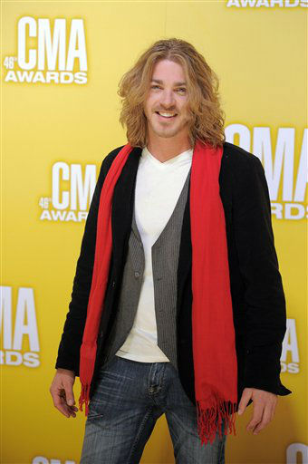 "<div class=""meta image-caption""><div class=""origin-logo origin-image ""><span></span></div><span class=""caption-text"">Bucky Covington arrives at the 46th Annual Country Music Awards at the Bridgestone Arena on Thursday, Nov. 1, 2012, in Nashville, Tenn.   (Photo/Chris Pizzello)</span></div>"