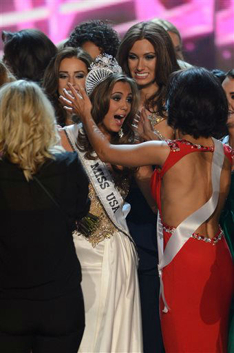 Miss Connecticut Erin Brady, center, reacts after winning the Miss USA 2013 pageant, Sunday, June 16, 2013, in Las Vegas.   <span class=meta>(AP Photo&#47; Jeff Bottari)</span>