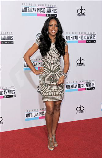 "<div class=""meta ""><span class=""caption-text "">Kelly Rowland arrives at the 40th Anniversary American Music Awards on Sunday, Nov. 18, 2012, in Los Angeles. (Photo by Jordan Strauss/Invision/AP)</span></div>"