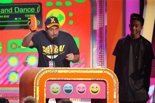 Adam Sandler accepts the award for favorite voice in an animated movie for ?Hotel Transylvania? at the 26th annual Nickelodeon&#39;s Kids&#39; Choice Awards on Saturday, March 23, 2013, in Los Angeles. &#40;Photo by John Shearer&#47;Invision&#47;AP&#41; <span class=meta>(Photo&#47;John Shearer)</span>