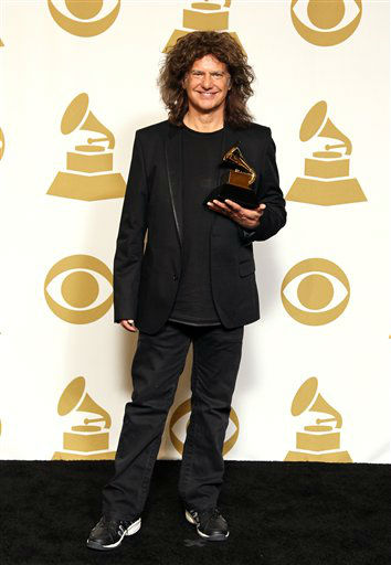 Pat Metheny poses backstage with the jazz instrumental album award for &#34;Unity Band&#34; backstage at the 55th annual Grammy Awards on Sunday, Feb. 10, 2013, in Los Angeles.  <span class=meta>(AP photo)</span>