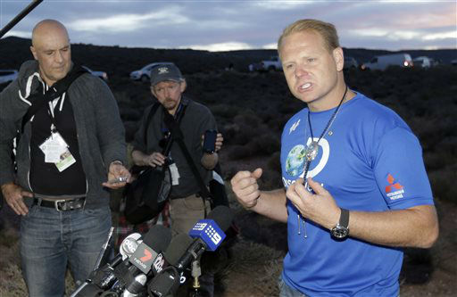 Daredevil Nik Wallenda makes remarks during a news conference after crossing a tightrope 1,500 feet above the Little Colorado River Gorge Sunday, June 23, 2013, on the Navajo reservation outside the boundaries of Grand Canyon National Park.  Wallenda completed the tightrope walk that took him a quarter mile across the gorge in just more than 22 minutes.  <span class=meta>(AP Photo&#47; Rick Bowmer)</span>