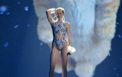 Miley Cyrus performs at the American Music Awards at the Nokia Theatre L.A. Live on Sunday, Nov. 24, 2013, in Los Angeles. (Photo by John Shearer/Invision/AP)