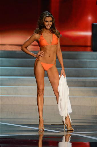 "<div class=""meta ""><span class=""caption-text "">Miss Connecticut Erin Brady walks the runway during the swimsuit competition of the Miss USA 2013 pageant, Sunday, June 16, 2013, in Las Vegas. Erin Brady of South Glastonbury, Conn., won the beauty pageant at the Planet Hollywood hotel-casino after strutting in a white sparkly gown and answering a question about the U.S. Supreme Court's decision upholding widespread DNA tests.  (AP Photo/ Jeff Bottari)</span></div>"