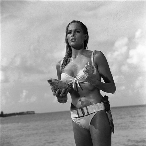 "<div class=""meta ""><span class=""caption-text "">This undated publicity photo provided by United Artists and Danjaq, LLC shows Ursula Andress in a scene from the James Bond film, ""Dr. No."" Her image personifies the gorgeous, mysterious cool of the Bond girl. The film is included in the MGM and 20th Century Fox Home Entertainment Blu-Ray ""Bond 50"" anniversary set. (AP Photo/United Artists and Danjaq, LLC) (AP Photo/ Uncredited)</span></div>"