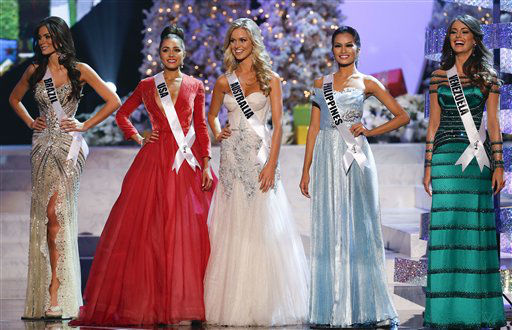 "<div class=""meta image-caption""><div class=""origin-logo origin-image ""><span></span></div><span class=""caption-text"">The remaining five contestants, from left, Miss Brazil, Gabriela Markus; Miss USA, Olivia Culpo; Miss Australia, Renae Ayris; Miss Philippines, Janine Tugonon; and Miss Venezuela, Irene Sofia Esser Quintero; stand together during the Miss Universe competition, Wednesday, Dec. 19, 2012, in Las Vegas.               (AP Photo/ Julie Jacobson)</span></div>"