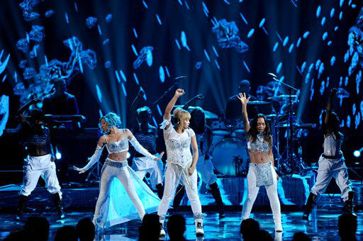 From right, Chilli and T-Boz of the musical group TLC perform with Lil Mama on stage at the American Music Awards at the Nokia Theatre L.A. Live on Sunday, Nov. 24, 2013, in Los Angeles. &#40;Photo by John Shearer&#47;Invision&#47;AP&#41; <span class=meta>(Photo&#47;John Shearer)</span>
