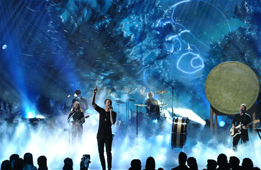 Dan Reynolds of the musical group Imagine Dragons performs on stage at the American Music Awards at the Nokia Theatre L.A. Live on Sunday, Nov. 24, 2013, in Los Angeles. (Photo by John Shearer/Invision/AP)