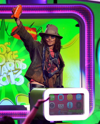 "<div class=""meta ""><span class=""caption-text "">Johnny Depp accepts the award for favorite movie actor for ?Dark Shadows? at the 26th annual Nickelodeon's Kids' Choice Awards on Saturday, March 23, 2013, in Los Angeles. (Photo by John Shearer/Invision/AP) (Photo/John Shearer)</span></div>"