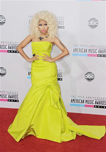 "<div class=""meta ""><span class=""caption-text "">Nicki Minaj arrives at the 40th Anniversary American Music Awards on Sunday, Nov. 18, 2012, in Los Angeles. (Photo by Jordan Strauss/Invision/AP)</span></div>"