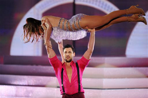 Maksim Chmerkovskiy, seen standing, performs with Jennifer Lopez at the American Music Awards at the Nokia Theatre L.A. Live on Sunday, Nov. 24, 2013, in Los Angeles. &#40;Photo by John Shearer&#47;Invision&#47;AP&#41; <span class=meta>(Photo&#47;John Shearer)</span>