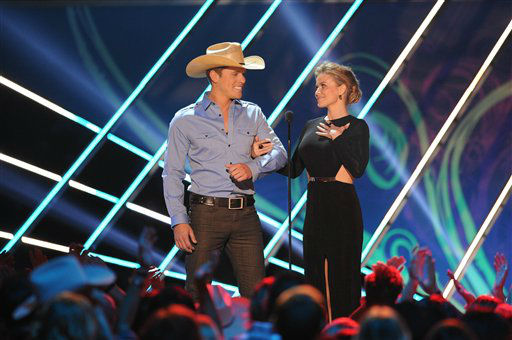 Dustin Lynch and Carmen Electra appear on stage during the American Country Awards on Monday, Dec. 10, 2012, in Las Vegas. &#40;Photo by Al Powers&#47;Powers Imagery&#47;Invision&#47;AP&#41; <span class=meta>(Photo&#47;Al Powers)</span>