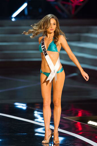 In this photo provided by the Miss Universe Organization,  Miss New York USA 2013, Joanne Nosuchinsky,  competes in her swimsuit during the  2013 Miss USA Competition Preliminary Show in Las Vegas on Wednesday June 12, 2013.   She will compete for the title of Miss USA 2013 and the coveted Miss USA Diamond Nexus Crown on June 16, 2013.    <span class=meta>(AP Photo&#47; Darren Decker)</span>