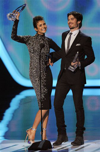 "<div class=""meta image-caption""><div class=""origin-logo origin-image ""><span></span></div><span class=""caption-text"">Nina Dobrev, left, and Ian Somerhalder accept the award for favorite on-screen chemistry for ?The Vampire Diaries? at the 40th annual People's Choice Awards at the Nokia Theatre L.A. Live on Wednesday, Jan. 8, 2014, in Los Angeles.   (Photo/Chris Pizzello)</span></div>"