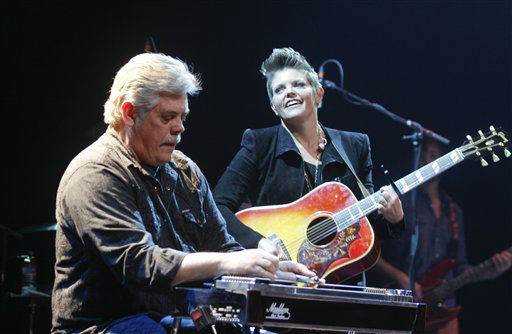 Natalie Maines performs with her father, Lloyd Maines playing keyboard during the SXSW Music Festival, on Wednesday, March 13, 2013 in Austin, Texas.   <span class=meta>(Photo&#47;Jack Plunkett)</span>