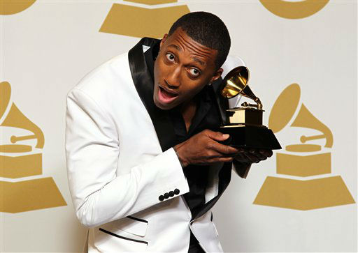 "<div class=""meta image-caption""><div class=""origin-logo origin-image ""><span></span></div><span class=""caption-text"">LeCrae poses backstage with the best gospel album award for ""Gravity"" at the 55th annual Grammy Awards on Sunday, Feb. 10, 2013, in Los Angeles.  (AP photo)</span></div>"