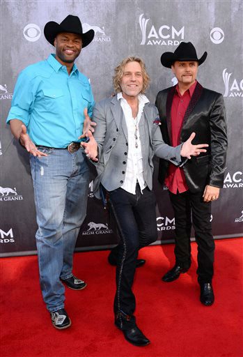 Cowboy Troy, left, and from right, John Rich and Big Kenny, of the musical group Big &amp; Rich, arrive at the 49th annual Academy of Country Music Awards at the MGM Grand Garden Arena on Sunday, April 6, 2014, in Las Vegas. &#40;Photo by Al Powers&#47;Powers Imagery&#47;Invision&#47;AP&#41; <span class=meta>(Al Powers&#47;Powers Imagery)</span>