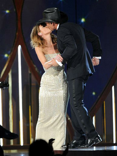 Faith Hill, left, and Tim McGraw kiss on stage at the 49th annual Academy of Country Music Awards at the MGM Grand Garden Arena on Sunday, April 6, 2014, in Las Vegas. &#40;Photo by Chris Pizzello&#47;Invision&#47;AP&#41; <span class=meta>(Photo&#47;Chris Pizzello)</span>