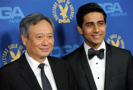 Director Ang Lee, left, and actor Suraj Sharma arrive at the 65th Annual Directors Guild of America Awards at the Ray Dolby Ballroom on Saturday, Feb. 2, 2013, in Los Angeles. (Photo by Chris Pizzello/Invision/AP)