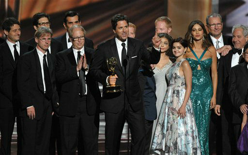 "<div class=""meta image-caption""><div class=""origin-logo origin-image ""><span></span></div><span class=""caption-text"">Steven Levitan, center, and the cast and crew of ""Modern Family"" accept the outstanding comedy series award at the 64th Primetime Emmy Awards at the Nokia Theatre on Sunday, Sept. 23, 2012, in Los Angeles. (Photo by John Shearer/Invision/AP) (Photo/John Shearer)</span></div>"