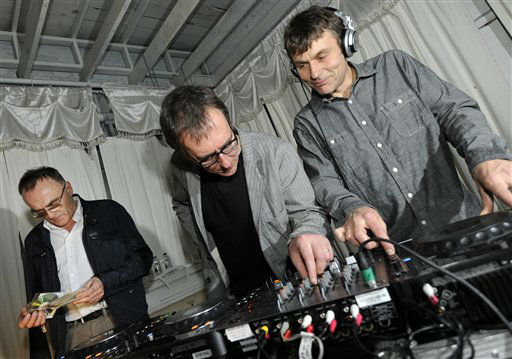 IMAGE DISTRIBUTED FOR FOX SEARCHLIGHT - From left, director Danny Boyle spins with Rick Smith and Darren Price from The Underworld during the Fox Searchlight party for Trance at SXSW in Austin, Texas Saturday, March 9, 2013.  &#40;Photo byJack Dempsey&#47;Invision for Fox Searchlight&#47;AP Images&#41; <span class=meta>(Photo&#47;Jack Dempsey)</span>