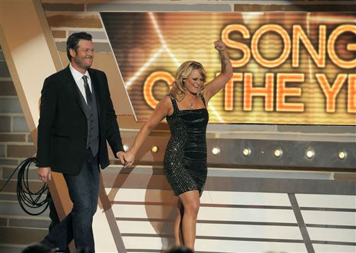 Miranda Lambert, right, and Blake Shelton walk on stage to accept the award for song of the year for &#34;Over You&#34; at the 48th Annual Academy of Country Music Awards at the MGM Grand Garden Arena in Las Vegas on Sunday, April 7, 2013. <span class=meta>(AP photo)</span>