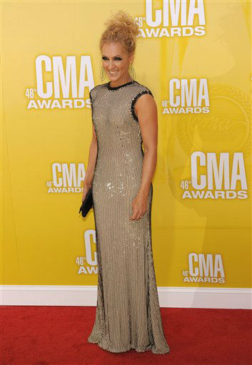Kimberly Schlapman, of musical group Little Big Town, arrives at the 46th Annual Country Music Awards at the Bridgestone Arena on Thursday, Nov. 1, 2012, in Nashville, Tenn.   <span class=meta>(Photo&#47;Chris Pizzello)</span>