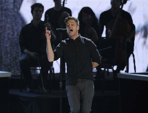 "<div class=""meta ""><span class=""caption-text "">Ryan Tedder, of the musical group OneRepublic, performs ""Counting Stars"" on stage at the 40th annual People's Choice Awards at the Nokia Theatre L.A. Live on Wednesday, Jan. 8, 2014, in Los Angeles.   (Photo/Chris Pizzello)</span></div>"
