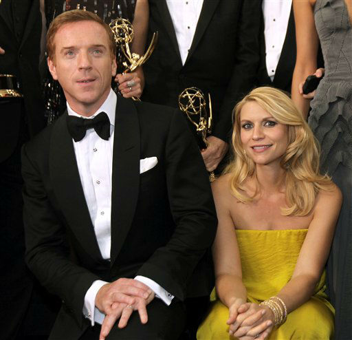 "<div class=""meta ""><span class=""caption-text "">Actor Damien Lewis, left, winner of the Emmy for outstanding lead actor in a drama series for ""Homeland"" and actress Claire Danes, winner of the Emmy for outstanding lead actress in a drama series, also for ""Homeland"", pose backstage at the 64th Primetime Emmy Awards at the Nokia Theatre on Sunday, Sept. 23, 2012, in Los Angeles. (Photo by Matt Sayles/Invision/AP) (Photo/Matt Sayles)</span></div>"