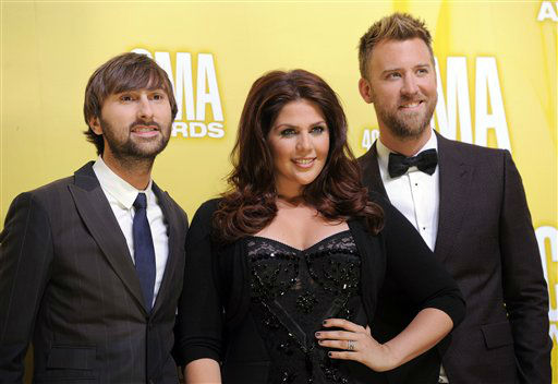 "<div class=""meta image-caption""><div class=""origin-logo origin-image ""><span></span></div><span class=""caption-text"">Musical group Lady Antebellum, from left, Dave Haywood, Hillary Scott and Charles Kelley, arrive at the 46th Annual Country Music Awards at the Bridgestone Arena on Thursday, Nov. 1, 2012, in Nashville, Tenn.   (Photo/Chris Pizzello)</span></div>"