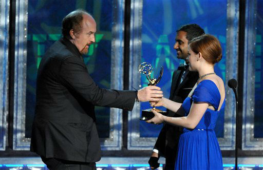 Jany Levy, right, and Aziz Ansari present the award for outstanding writing in variety special to Louis C.K., left, for &#34;Louis C.K. Live at the Beacon Theatre&#34; at the 64th Primetime Emmy Awards at the Nokia Theatre on Sunday, Sept. 23, 2012, in Los Angeles. &#40;Photo by John Shearer&#47;Invision&#47;AP&#41; <span class=meta>(Photo&#47;John Shearer)</span>