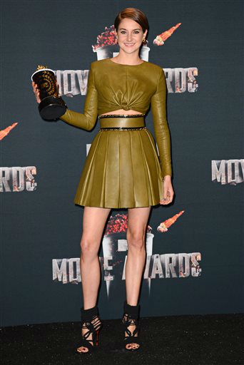 "<div class=""meta image-caption""><div class=""origin-logo origin-image ""><span></span></div><span class=""caption-text"">Shailene Woodley poses in press room with her award for favorite character for ""Divergent"" at the MTV Movie Awards on Sunday, April 13, 2014, at Nokia Theatre in Los Angeles. (Photo by Jordan Strauss/Invision/AP) (Photo/Jordan Strauss)</span></div>"