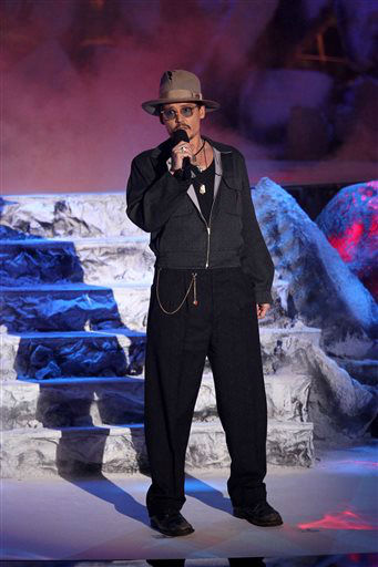 "<div class=""meta image-caption""><div class=""origin-logo origin-image ""><span></span></div><span class=""caption-text"">Johnny Depp presents the award for movie of the year on stage at the MTV Movie Awards on Sunday, April 13, 2014, at Nokia Theatre in Los Angeles. (Photo by Matt Sayles/Invision/AP) (Photo/Matt Sayles)</span></div>"