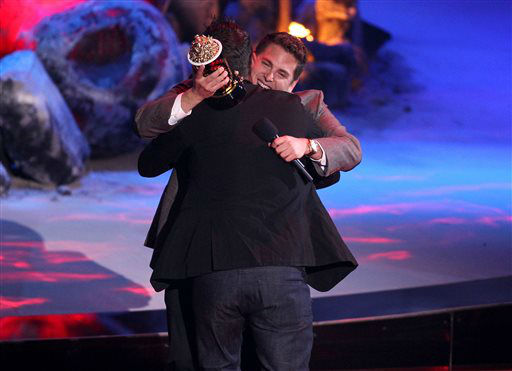 Jonah Hill, right, presents the trailblazer award to Channing Tatum on stage at the MTV Movie Awards on Sunday, April 13, 2014, at Nokia Theatre in Los Angeles. &#40;Photo by Matt Sayles&#47;Invision&#47;AP&#41; <span class=meta>(Photo&#47;Matt Sayles)</span>