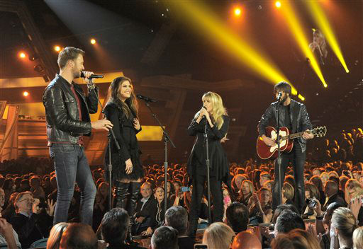 Stevie Nicks, second from right, and from left, Charles Kelley, Hillary Scott and Dave Haywood, of the musical group Lady Antebellum, perform on stage at the 49th annual Academy of Country Music Awards at the MGM Grand Garden Arena on Sunday, April 6, 2014, in Las Vegas. &#40;Photo by Chris Pizzello&#47;Invision&#47;AP&#41; <span class=meta>(Photo&#47;Chris Pizzello)</span>