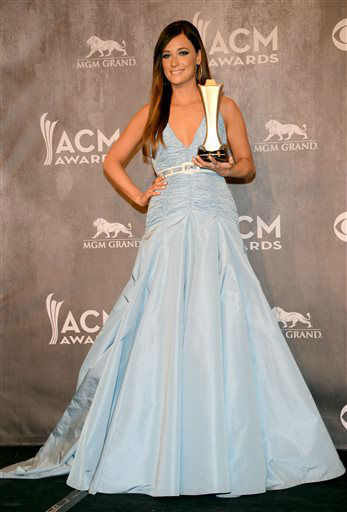 Kacey Musgraves poses in the press room with the award for album of the year at the 49th annual Academy of Country Music Awards at the MGM Grand Garden Arena on Sunday, April 6, 2014, in Las Vegas. &#40;Photo by Al Powers&#47;Powers Imagery&#47;Invision&#47;AP&#41; <span class=meta>(Al Powers&#47;Powers Imagery)</span>