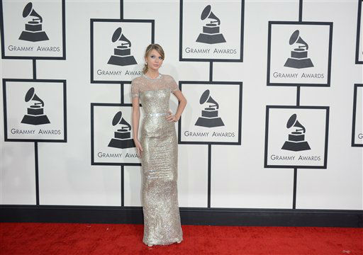 "<div class=""meta image-caption""><div class=""origin-logo origin-image ""><span></span></div><span class=""caption-text"">Taylor Swift arrives at the 56th annual GRAMMY Awards at Staples Center on Sunday, Jan. 26, 2014, in Los Angeles.  (Photo/Jordan Strauss)</span></div>"