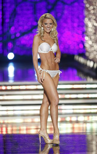 "<div class=""meta image-caption""><div class=""origin-logo origin-image ""><span></span></div><span class=""caption-text"">Miss Washington Mandy Schendel competes in the swimsuit portion of the Miss America 2013 pageant on Saturday, Jan. 12, 2013, in Las Vegas.   (AP Photo/ Isaac Brekken)</span></div>"