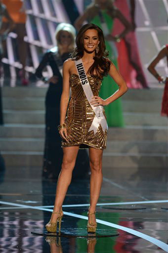 "<div class=""meta ""><span class=""caption-text "">Miss Illinois Stacie Juris from Tinley Park walks the runway during the introductions of the Miss USA 2013 pageant, Sunday, June 16, 2013, in Las Vegas.  (AP Photo/ Jeff Bottari)</span></div>"