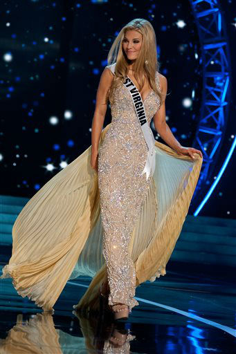 This photo provided by the Miss Universe Organization, Miss West Virginia USA 2013, Chelsea Welch competes in her evening gown during the 2013 Miss USA Competition Preliminary Show  in Las Vegas  on Wednesday June 12, 2013.  She will compete for the title of Miss USA 2013 and the coveted Miss USA Diamond Nexus Crown on June 16, 2013.    <span class=meta>(AP Photo&#47; Patrick Prather)</span>