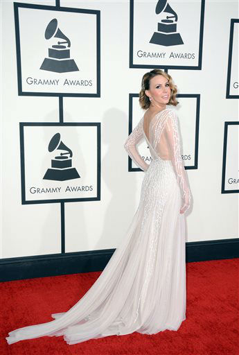"<div class=""meta image-caption""><div class=""origin-logo origin-image ""><span></span></div><span class=""caption-text"">Keltie Knight arrives at the 56th annual GRAMMY Awards at Staples Center on Sunday, Jan. 26, 2014, in Los Angeles.   (Photo/Jordan Strauss)</span></div>"