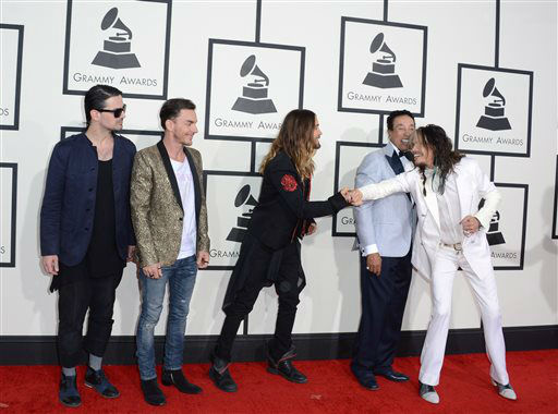 "<div class=""meta image-caption""><div class=""origin-logo origin-image ""><span></span></div><span class=""caption-text"">Tomo Milicevic, from left, Shannon Leto, Jared Leto, Smokey Robinson and Steven Tyler arrive at the 56th annual Grammy Awards at Staples Center on Sunday, Jan. 26, 2014, in Los Angeles.  (Photo/Jordan Strauss)</span></div>"