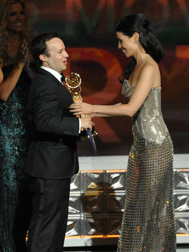 Lucy Liu, right, presents the award for Outstanding Writing In A Miniseries Or Movie to Danny Strong for &#34;Game Change&#34; at the 64th Primetime Emmy Awards at the Nokia Theatre on Sunday, Sept. 23, 2012, in Los Angeles. &#40;Photo by John Shearer&#47;Invision&#47;AP&#41; <span class=meta>(Photo&#47;John Shearer)</span>
