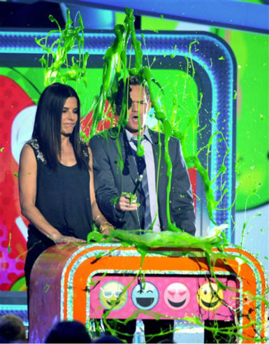 Sandra Bullock and Neil Patrick Harris get slimed as they present the award for favorite movie actress at the 26th annual Nickelodeon&#39;s Kids&#39; Choice Awards on Saturday, March 23, 2013, in Los Angeles. &#40;Photo by John Shearer&#47;Invision&#47;AP&#41; <span class=meta>(Photo&#47;John Shearer)</span>